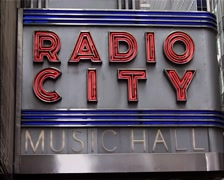 Whip on to Radio City Music Hall sign, New York GFSD Stock Footage