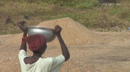 Stock Video Footage of Africa: poor laborers sifting gravel