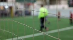 Kids leaving indoor soccer field Stock Footage