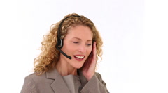 Curly blond haired woman talking on the phone - stock footage