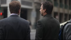 Business Men on Street Corner in Financial District Stock Footage
