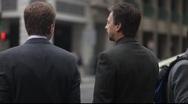 Business Men on Street Corner in Financial District Stock Footage