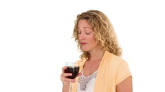 Blond woman enjoying glass of red wine Stock Footage