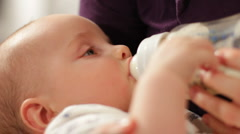 Baby feeding 2 - stock footage