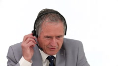 An ederly businessman talking on the phone Stock Footage