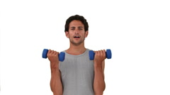 Dark-haired man in sportwear doing exercise Stock Footage