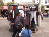 Stock Video Footage of Seller with chief headdress