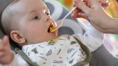 Infant eating baby meal 2 Stock Footage