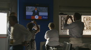 Journalists watch President Obama on television at the G8 media camp Stock Footage