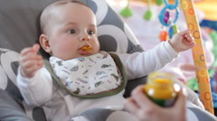 Infant eating baby meal 1 Stock Footage