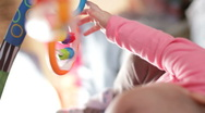 Infant on a play gym 9 Stock Footage