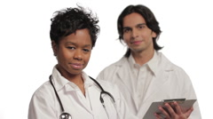 Two confident doctors, woman in foreground Stock Footage
