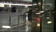 Woman Waiting in Airport Stock Footage