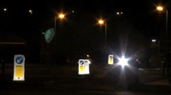 Illuminated Bollards and Passing Car Stock Footage