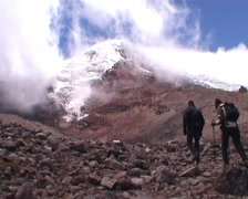Chimborazo, at base of volcano, people climbing - stock footage