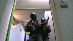 Special Forces securing door - 2 CLIPS - stock footage