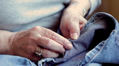 Old woman hands sewing Stock Footage