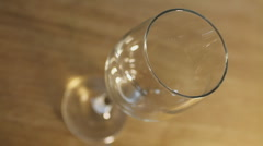Cola Splashing into Wineglass in slow motion Stock Footage