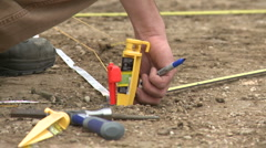 Measuring and Excavating Stock Footage