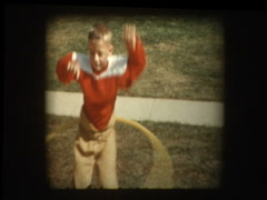 Young boy in football uniform does Hula Hoop - stock footage