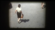Stock Video Footage of 50's woman with sunglasses realizes she's being filmed