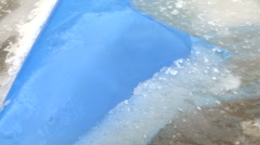 Blue tarp frozen in ice Stock Footage