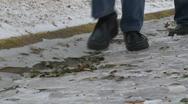 Walking on a frozen road (slow motion) Stock Footage