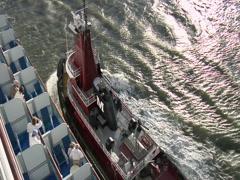 Tugboat alongside Cruiseship in Harbor Stock Footage