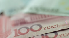 Rack focus from Chinese Yuan to Euros Stock Footage