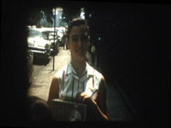 NYC street 1957 girl shows off old time radio Stock Footage
