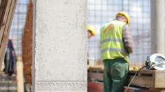 Workers busy at construction site Stock Footage
