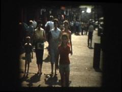 Family walks ocean boardwalk Stock Footage