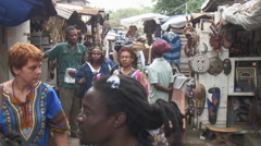 Africa: vendors and shoppers in outdoor market Stock Footage