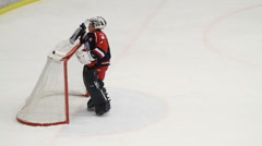 Ice hockey goalie wiping sweat off his face Stock Footage