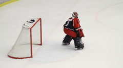 Goalie making a save in an ice hockey game Stock Footage