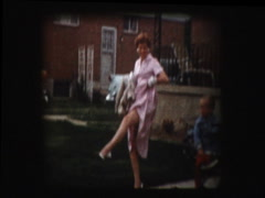 50s woman shows off her legs - stock footage