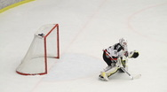 Goalie saves a shot in an ice hockey game Stock Footage