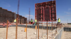 Crane move metal part at the construction site Stock Footage