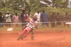 Motocross rider in Uganda, East Africa Stock Footage