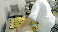 Timelapse of pastry bases being made at a commercial bakery - stock footage