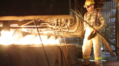 Worker and machinery at the foundry - stock footage