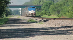 Amtrak train going down tracks no logos. - stock footage