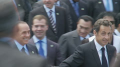 President Obama, plus other leaders walk past Gaddafi at the G8 summit - stock footage