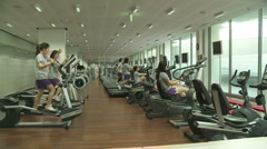 Young women at the gym - stock footage