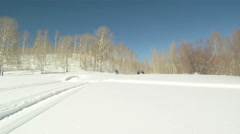 Following snowmobiles on mountain P HD 06 Stock Footage