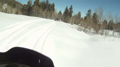 Snowmobile following rider on mountain P HD 04 Stock Footage