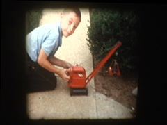 Little boy plays with antique toy construction crane Stock Footage