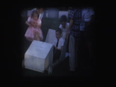 Kids play in soap box derby car Stock Footage