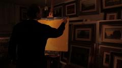 Painter paints a picture of a landscape - 7 footage Stock Footage