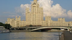 Ship pass by high-rise building at Kotelnicheskaya Embankment Stock Footage